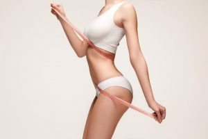 the-girl-taking-measurements-of-her-body-white-background-picture-id651472728 (3)